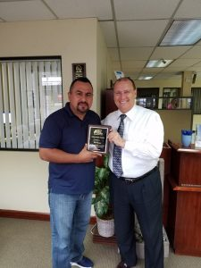 Craig Candelore of the Men's Legal Center presenting Joe Vargas with Great Dad Award