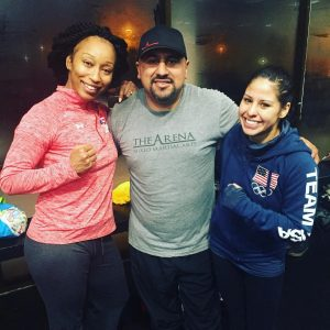 Joe Vargas working with 2012 USA Boxing National Champion Raquel Miller (left) and U.S. 2012 Olympic Bronze Medalist Marlen Esparza (right)